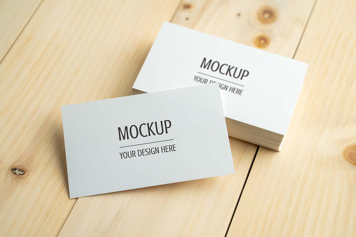 Business card mockup, Blank white business card on wood table PS